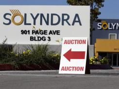 An auction sign Oct. 31 at bankrupt Solyndra headquarters in Fremont, Calif.