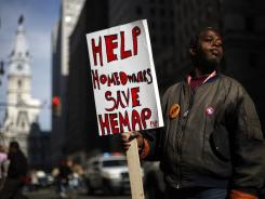 Levy Brown and others in Philadelphia Nov. 3, 2011,  want  the state to re-establish the Homeowners Emergency Mortgage Assistance Program (HEMAP).