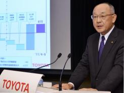 Japan's auto giant Toyota Motor executive vice president Satoshi Ozawa announces the company's first half financial result in Tokyo on November 8, 2011.