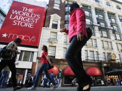 Pedestrians pass the Macy's department store in New York, Nov. 8, 2011.