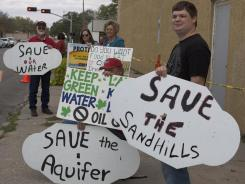 Demonstrators in Norfolk, Neb., on Oct. 11, 2011, protest the proposed Keystone XL pipeline.