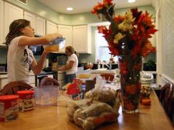 Hannah Hoffmann, 12, and her mother Melissa Hoffmann,  prepare Thanksgiving dinner on Nov. 24, 2010, at their home in San Carlos Park, Fla.