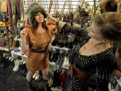 Brady Kimball and her friend Aleksandra Beaucher try on hats during a shopping trip to a local boutique Meowdy in the Los Feliz neighborhood of Los Angeles.