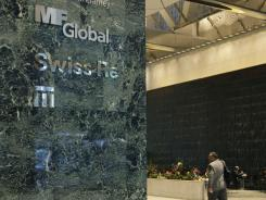 A sign for defunct trading company MF Global is displayed at an office building in New York on Nov. 2, 2011.