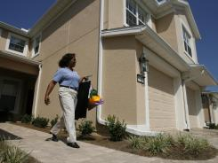 Donesta Lay stayed within Jacksonville, Fla., when she moved into Sweetwater, an active-adult community. Moving is at a historic low due to the recession and faltering housing market, demographers say.
