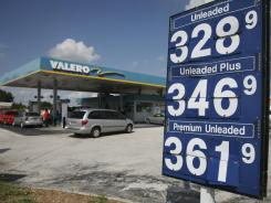 Motorists look for an empty gas pump at a Valero gas station in Miami Gardens, Fla., in October.