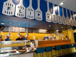 The new IHOP express has a  different look and feel than a conventional IHOP including an interactive syrup bar and an open grill &quot;Flip Kitchen.&quot;