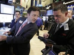 A specialist and a trader on the floor of the New York Stock Exchange on Nov. 9, 2011.