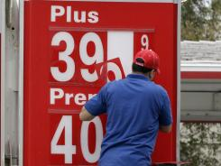 Gas prices are changed at a station in Oakland, Calif. on Nov. 11, 2011.