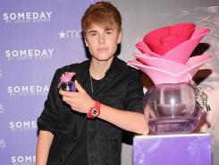 "Pop singer Justin Bieber makes an appearance at Macy's to launch his new fragrance ""Someday"" in June 2011."