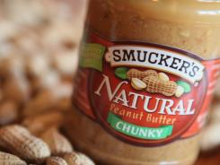 In this photo illustration, a jar of Smucker's Natural peanut butter is pictured on October 12, 2011 in Chicago, Illinois.