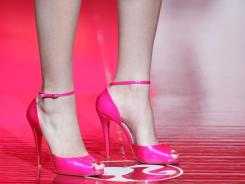 A model wears high heel shoes by Christian Louboutin at the Barbie 50th Anniversary fashion celebration during fashion week 2009 in New York.