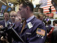 Traders on the floor of the New York Stock Exchange on Nov. 21, 2011.