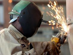 As older workers retire, companies are looking for skilled welders such as Patrick Benjamin, above, and machinists more than college-educated professionals like lawyers.