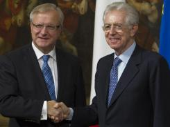 "European Commissioner for the Economy Olli Rehn, left, says the economic  reforms instituted by Italian Premier Mario Monti, right, are ""going in the right direction,"" but he says more action is needed."