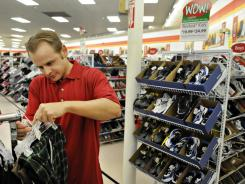 """Something to look forward to"":  Lloyd Slocum is working part time at Bealls Outlet Store in Port St. Lucie, Fla. He was unemployed for 18 months before he was hired to work during the holidays."