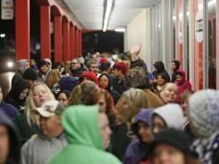 Black Friday shoppers line up outside of a Kmart store in Salem, Ore., early Friday, Nov. 25.
