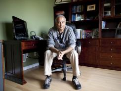 Karthik Krishnan in his office in the home he shares with his wife in South River, N.J.