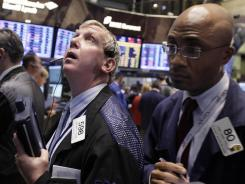 Traders Richard Cohen, center, and Lewis Vande-Pallen, right, on the floor of the New York Stock Exchange last week.