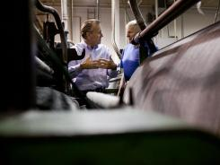 Chuck Mooty, left, CEO of Faribault Woolen Mills, discusses a production process with Dennis Gregor. Mooty said he dedicates himself to learning from his employees.