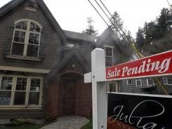 This Nov. 28, 2011, photo shows a pending sale home in Portland, Ore.