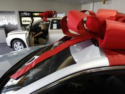 Robin Steinberg, of Malibu, Calif., shops for a Lexus  at Jim Falk Lexus in Beverly Hills, Calif.