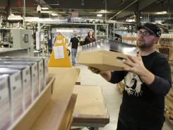 A worker loads a pallet of Nintendo 3DS handheld gaming systems at the Nintendo of America distribution center in North Bend, Wash., on Nov. 16, 2011.