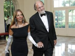 Jon Corzine, and his wife arrive for a State Dinner in honor of Angela Merkel at the White House on June 7, 2011.