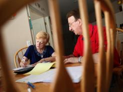 Bob and Connie Cabana spend much of their time together discussing finances at their kitchen table in their Tampa home.