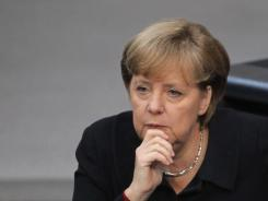 German Chancellor Angela Merkel speaks at the Bundestag in Berlin on Dec. 2, 2011.