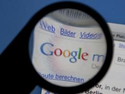 A magnifying glass is used to illustrate Google's approval by the U.S. Justice Dept. Dec. 2, 2011, to acquire Admeld, an online ad service.