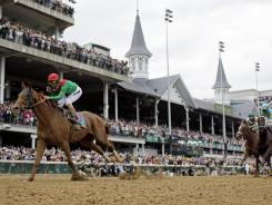 John Velazquez rides Animal Kingdom to victory during the 137th Kentucky Derby horse race at Churchill Downs on May 7, 2011, in Louisville.