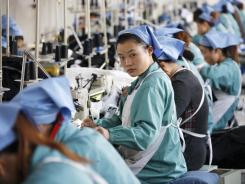 Textile factory employees in Huaibei in China's Anhui province. China's exports could get hit if Europe's troubles cause a global slowdown.