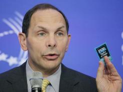 In this Sept. 22 file photo Robert McDonald, CEO and president of Procter & Gamble, holds a packet of PUR, a water purifier made by P&G, at the Clinton Global Initiative in New York.