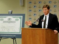 Green Bay Packers president Mark Murphy talks with reporters about the stock sale at the Lambeau Field on Dec. 6, 2011.
