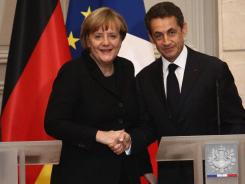 German Chancellor Angela Merkel (left) and French President Nicolas Sarkozy attend a joint press conference for the launch of Eurozone crisis talks at Elysee Palace in Paris.