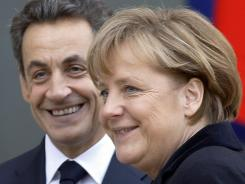 French President Nicolas Sarkozy and German Chancellor Angela Merkel prior to a Monday conference in Paris.