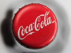 Displayed is a bottle cap on a bottle of Coca-Cola in Philadelphia in this file photo.