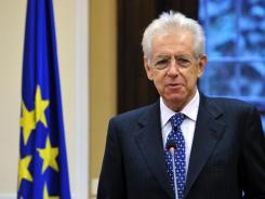 Italian Prime Minister Mario Monti speaks during a press conference in Milan.