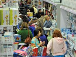 A Toys R Us store in Atlanta, Ga., is jammed with shoppers on Nov. 24, 2011.