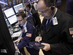 Traders on the floor of the New York Stock Exchange on Dec. 5, 2011.