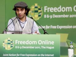 "Syrian blogger Amjad Baiazy speaks Friday during the ""Freedom Online"" conference at the Foreign Ministry in The Hague."