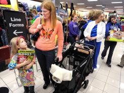 Shoppers wait in line at a Kohl's store on Black Friday in Owensboro, Ky.