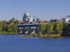 Pennsylvania is poised to take over its struggling capital of Harrisburg, which has $300 million in outstanding debt.