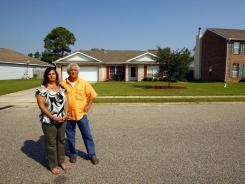 Steven and Lisa Maultsby outside the home they lost to foreclosure while awaiting a loan modification.