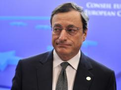 European Central Bank President Mario Draghi leaves after European Union talks at the EU headquarters in Brussels on Dec. 9, 2011.