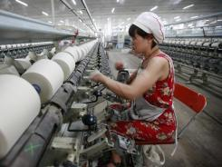 A worker operates at a textile factory Oct. 22 in Huaibei, east China's Anhui province.