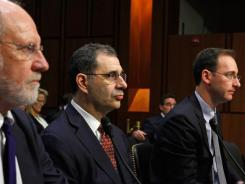 Former MF Global Chairman and CEO Jon Corzine, (left to right)  former President and COO Bradley Abelow and former CFO Henri Steenkamp testify before a Senate Committee on Dec. 13, 2011 in Washington, D.C.
