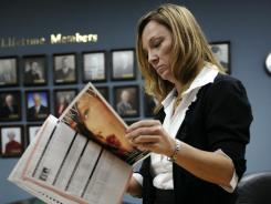 Heather Rolley, a Mary Kay sales associate,  reads through a company magazine after a sales meeting Dec. 13, 2011 in Lebanon, Tenn. (GEORGE WALKER IV / THE TENNESSEAN)