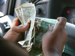 A shopper counting cash in Orlando, Fla.